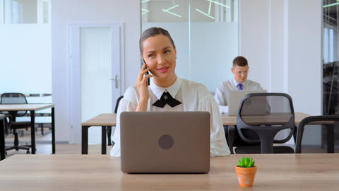 portrait businesswoman has phone negotiation at workplace Live Action