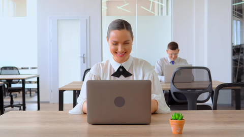 portrait businesswoman using laptop at workplace Live Action