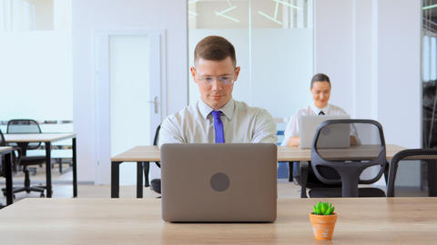 portrait businessman using laptop at workplace Live Action