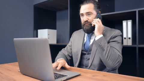 portrait middle aged businessman using cellphone call in office Live Action