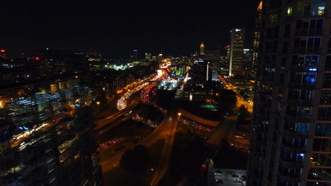 Flying between Atlanta Commercial Buildings at the Lit-up City Center Live Action