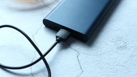Power bank for charging mobile devices on table Live Action