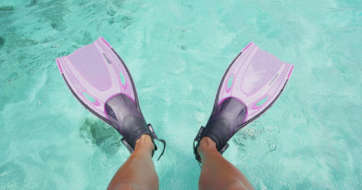 Travel vacation beach concept Snorkel feet snorkeler having fun with pink fins Live Action