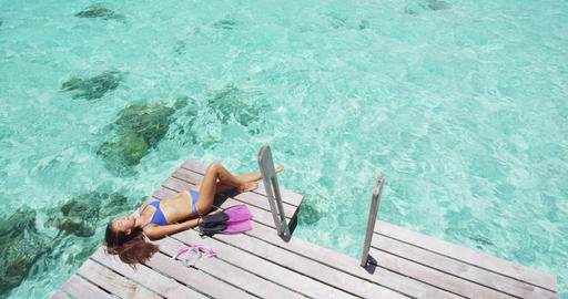 Tropical paradise travel holidays woman enjoying sun after snorkel swim Live Action