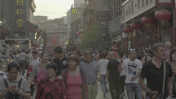 The Streets Of Beijing. People walking down the street. The city's skyline Footage