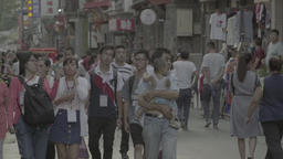 Asia. Beijing. China. Many pedestrians walk down a city street Footage