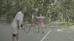 People play tennis in the Park. Beijing. China Live Action
