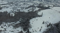 Winter scene, flying over hills and forest. aerial view Footage
