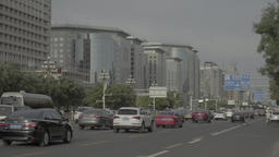 Cars driving on the road in Beijing. China Footage