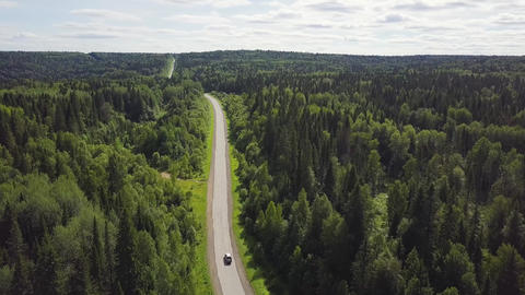 Aerial View Of White Car Driving On Country Road In Forest Live Action