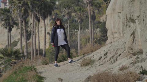 Active Senior woman walking at pedestrian trail Calafia Park San Clemente Live Action