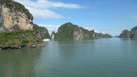 Mountain Islands Carst Limestone Cliffs and Pleasure Boat Cruises in Halong Bay Seen From Ship Live Action