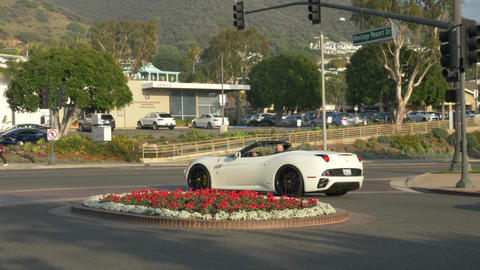 White ferrari car convertible with bold driver coming from Hotel Luxury Spa Live Action