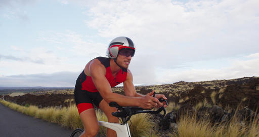 Triathlon man cycling - male triathlete biking on triathlon bike Live Action