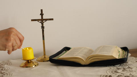 the faithful light a candle before prayer, the bible and cross ライブ動画