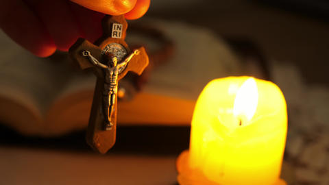 cross with Christ Jesus in twilight illuminated by candle light ライブ動画