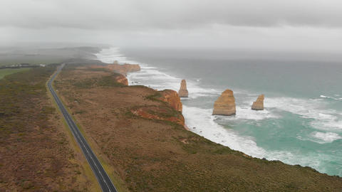 Twelve Apostles on a stormy day, aerial view from Great Ocean Road Live Action