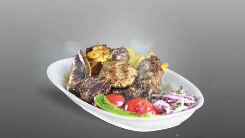 Mixed Kebab served with fried potato tomato and pepper on white plate on gray background Live Action