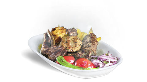 Mixed Kebab served with fried potato tomato and pepper on white plate on white background direction Live Action