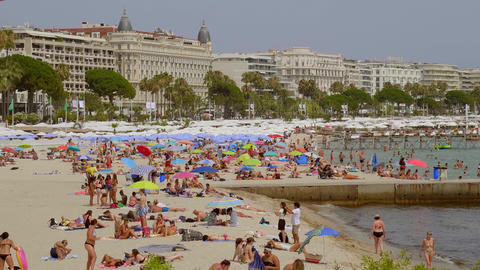 The famous beach of Cannes at the Croisette in summer - CITY OF CANNES, FRANCE - Live Action