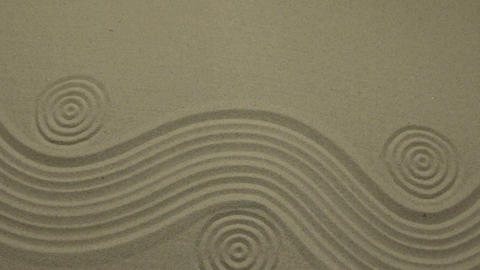 Zoom. Winding lines and circles in the sand. Crane shot Live Action