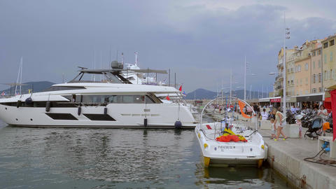 Luxury Yachts in the harbor of Saint Tropez - ST TROPEZ, FRANCE - JULY 13, 2020 Live Action