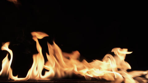 Slow motion, igniting fire on black background. Texture of fire on a black Live Action