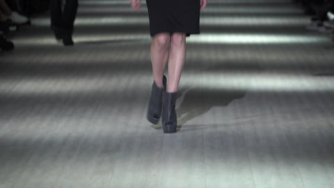 Fashion show. Woman model on the catwalk. Models. Slow motion Live Action