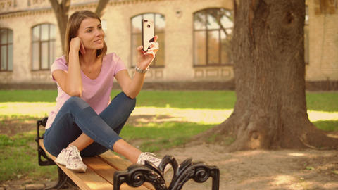 young woman has video call near college Live-Action
