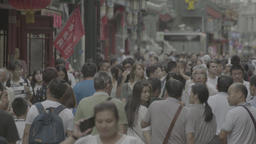 A crowd of people on a crowded street in Beijing. China. Time lapse Footage