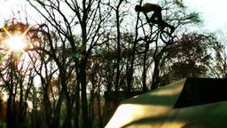 Bicycle acrobatics at sunset, slow motion Footage