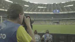 Photo.The photographer takes pictures during the match at the stadium Footage
