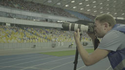 Journalism. Photographer at the stadium during the match. Media. Press Footage