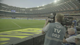 Media. Press. The cameraman in the stadium Footage