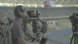 Press. Cameraman with a camera during a live TV broadcast Footage