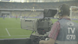 Cameraman with a camera during a live broadcast at the stadium Live Action