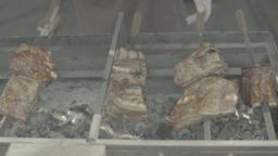Pieces of meat are fried on the grill over the coals Live Action