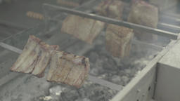 Pieces of meat roasted on a spit over the coals Live Action