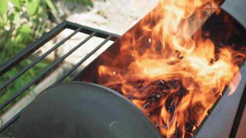 Cooking, oriental cuisine, forest fires, arson concept - lighting fire and coals Live Action