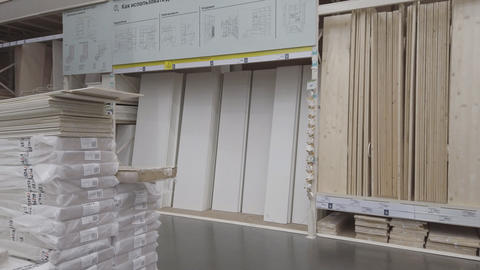 Construction lumber and wooden boards on a shelf in a construction store Live Action