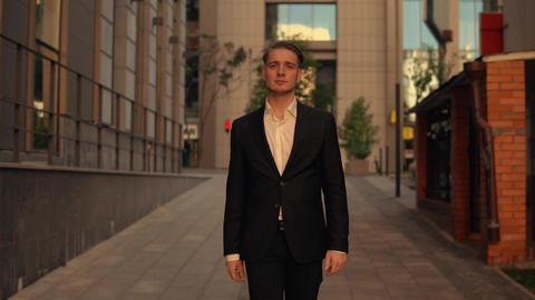 trendy man wearing elegant suit outdoor Live Action