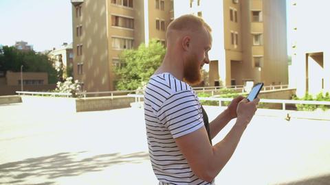 men standing near building messaging mobile Live Action