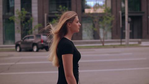 elegant businesswoman walks on street Live Action