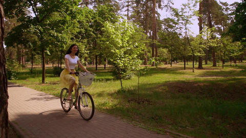 happy girl cycling on bicycle sunlight Live Action