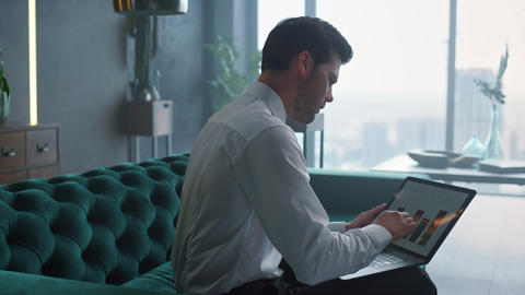 Businessman analyzing business graphs on laptop screen. Worker using laptop Live-Action