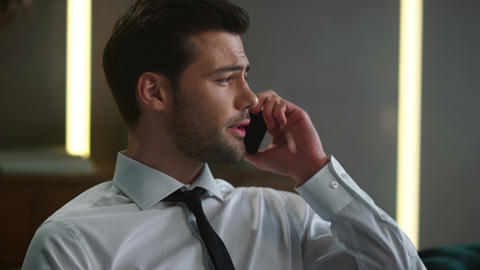 Businessman talking on smartphone in office. Employee calling on cellphone Live-Action