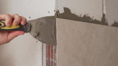 The bathroom tiles were glued to the wall. Master glues bathroom tiles. The Live Action