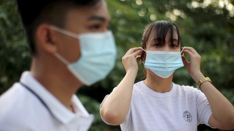 Selective Focus of Woman Wearing Her Face Mask Live Action
