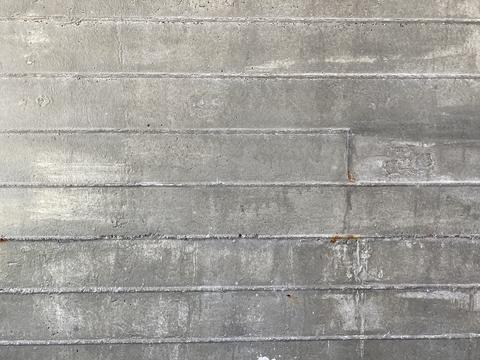 gray cement wall with rough lines Photo