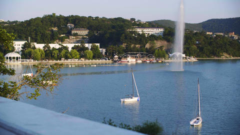 Sea landscape on green city highlands and yacht. Sea boat parking in sea Live Action